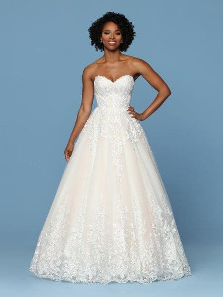 African american woman in embroidered wedding dress